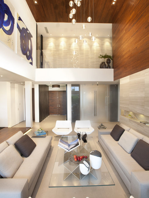Inspiration for a large modern living room remodel in Miami with beige walls