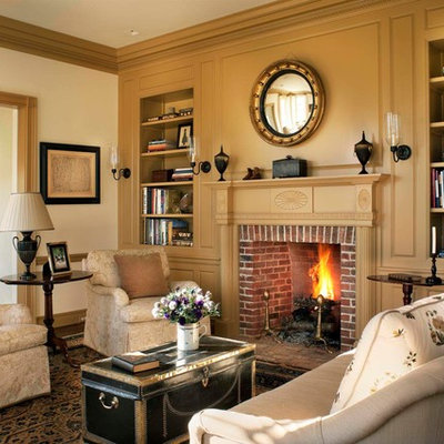 Country formal and enclosed living room photo in New York with a standard fireplace, a brick fireplace, no tv and yellow walls