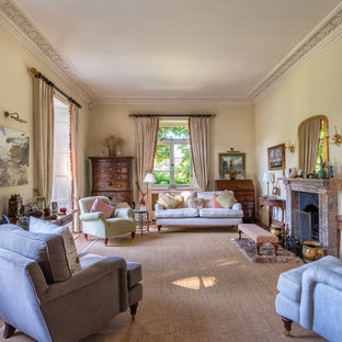 Expansive Victorian Formal Enclosed Living Room In Devon With Beige Walls,  Carpet, A Stone