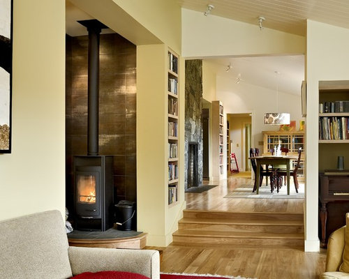 Contemporary living room idea in Burlington with a library, beige walls and  a wood stove - Woodstove Surround Houzz