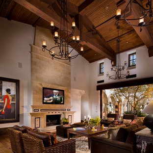 Tuscan living room photo in Orange County with a tile fireplace