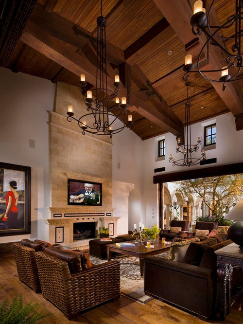 Tuscan Living Room Photo In Orange County With A Tile Fireplace Surround