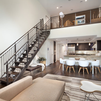 Inspiration for a contemporary open concept dark wood floor living room remodel in DC Metro with white walls