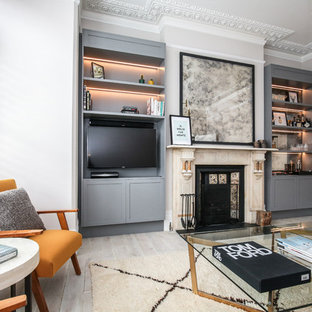 This Is An Example Of A Contemporary Living Room In London With Beige Walls,  Painted