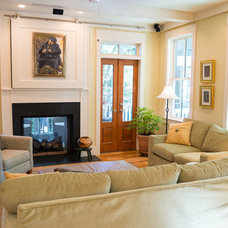 Farmhouse Living Room by Brookstone Builders