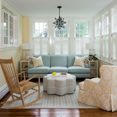 Inspiration for a small timeless open concept medium tone wood floor and brown floor living room remodel in Boston with yellow walls