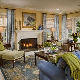 オレンジカウンティの大きいアジアンスタイルのおしゃれなLDK (フォーマル、黄色い壁、大理石の床、標準型暖炉、漆喰の暖炉まわり、テレビなし、マルチカラーの床) の写真