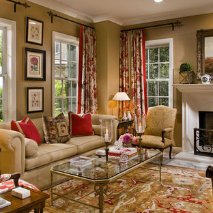 Living room - mid-sized traditional formal and enclosed marble floor and multicolored floor living room idea in Orange County with brown walls, a standard fireplace, a plaster fireplace and no tv