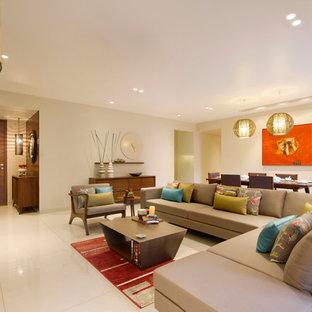 Mittelgroßes, Repräsentatives Modernes Wohnzimmer mit beiger Wandfarbe, Keramikboden und beigem Boden in Ahmedabad