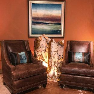 ダラスの中サイズのラスティックスタイルのおしゃれな独立型リビング (オレンジの壁、コンクリートの床、暖炉なし、テレビなし、グレーの床) の写真