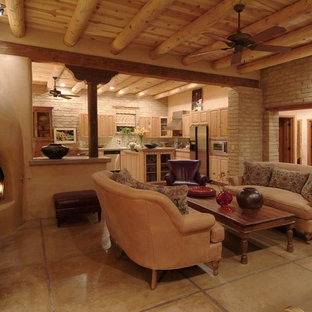フェニックスの大きいサンタフェスタイルのおしゃれなLDK (コンクリートの床、フォーマル、テレビなし、グレーの壁、コーナー設置型暖炉、コンクリートの暖炉まわり、ベージュの床) の写真