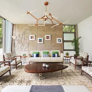 Modern inredning av ett stort vardagsrum, med ett finrum, vita väggar, klinkergolv i keramik och beiget golv