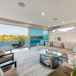 Design ideas for a beach style formal enclosed living room in Sydney with beige walls and beige floor.