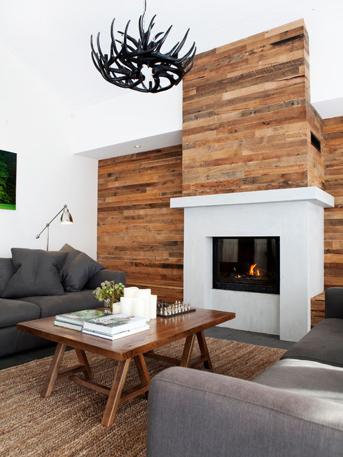Large trendy open concept living room photo in Melbourne with white walls,  a standard fireplace