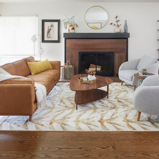 Example of a large 1960s open concept medium tone wood floor and brown floor living room design in San Francisco with white walls, a standard fireplace and a stone fireplace