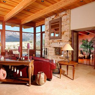 Ispirazione per un soggiorno american style con pareti beige, pavimento in marmo, camino bifacciale e cornice del camino in pietra