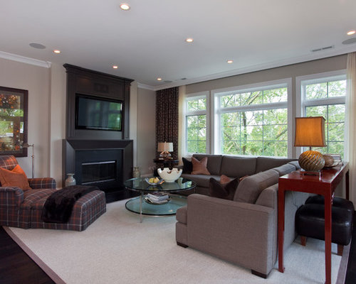 Example Of A Classic Living Room Design In Chicago With Beige Walls And Wall