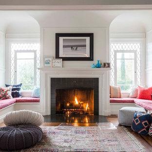 Foto de salón abierto, clásico renovado, grande, con paredes blancas, suelo de madera oscura, todas las chimeneas y marco de chimenea de baldosas y/o azulejos
