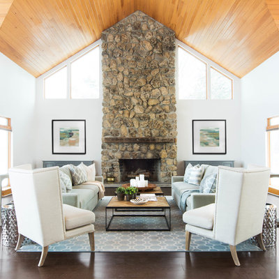 Cottage dark wood floor living room photo in Toronto with white walls, a standard fireplace and a stone fireplace