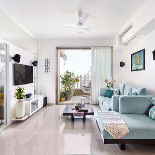 Foto di un soggiorno contemporaneo con pareti bianche, TV a parete e pavimento grigio