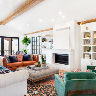 Example of a large transitional open concept medium tone wood floor and brown floor living room design in Salt Lake City with white walls and a standard fireplace