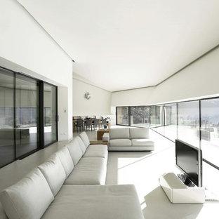 Esempio di un ampio soggiorno contemporaneo aperto con pareti bianche, TV autoportante e pavimento in gres porcellanato