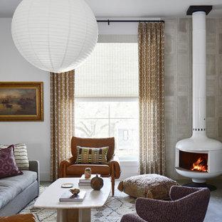オースティンの地中海スタイルのおしゃれなリビング (フォーマル、白い壁、コンクリートの床、薪ストーブ) の写真
