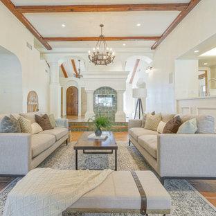 Foto di un soggiorno mediterraneo di medie dimensioni e aperto con sala formale, pareti grigie, pavimento in terracotta, nessuna TV e pavimento arancione