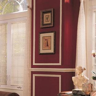 ボルチモアの大きいヴィクトリアン調のおしゃれなLDK (赤い壁、濃色無垢フローリング、木材の暖炉まわり、標準型暖炉) の写真