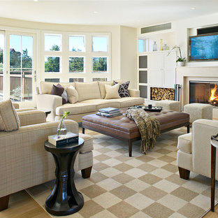 Photo of a large nautical living room in New York with a standard fireplace and a built-in media unit.