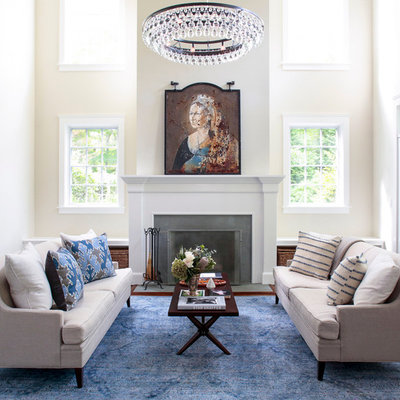 Living room - large traditional formal and open concept dark wood floor and brown floor living room idea in New York with beige walls, a standard fireplace, a stone fireplace and no tv