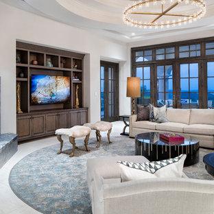 オースティンの巨大なトランジショナルスタイルのおしゃれなLDK (白い壁、コーナー設置型暖炉、石材の暖炉まわり、埋込式メディアウォール、白い床) の写真