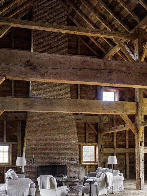 inspiration for a farmhouse open concept medium tone wood floor and brown floor living room remodel