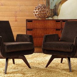 American Leather Marshall Chairs - Designed by John Mascheroni, the small scale Marshall is the epitome of mid century modern with classic contemporary straight edges mixed with a rounded wooden cross base featured on a memory swivel.