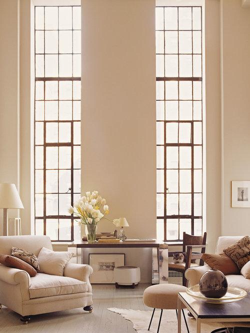 Elegant Living Room Photo In New York With Painted Wood Floors
