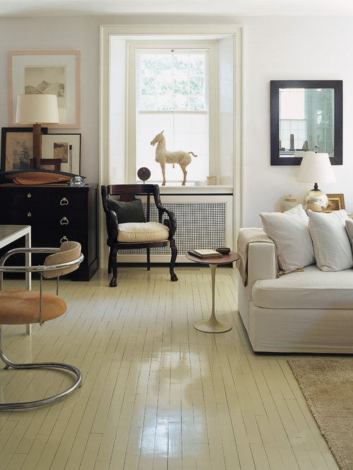Elegant living room photo in New York with painted wood floors and white  floors - Painted Wood Floor Houzz