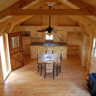 Living room - rustic living room idea in Huntington