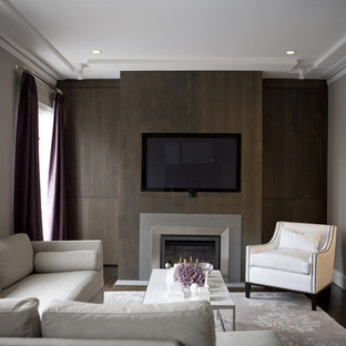 Inspiration for a contemporary living room remodel in San Francisco with gray walls, a standard fireplace and a media wall