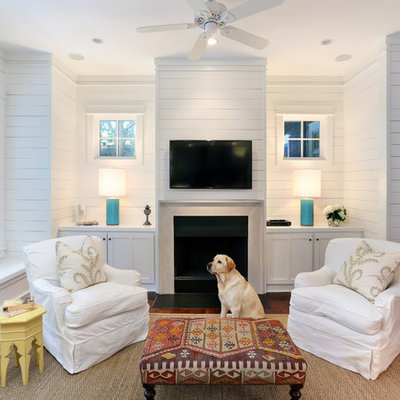 Mid-sized beach style enclosed medium tone wood floor living room photo in San Francisco with white walls and a wall-mounted tv