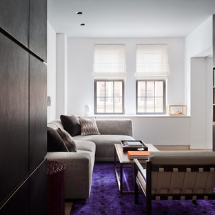 This is an example of a mid-sized contemporary enclosed living room in Auckland with white walls, carpet and purple floor.