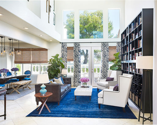 Example Of A Trendy Open Concept Living Room Library Design In Las Vegas  With White Walls Part 23