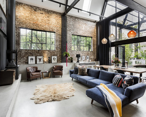 Design Ideas For An Expansive Industrial Open Concept Living Room In Sydney  With Concrete Floors,