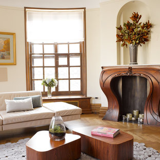 Mid-sized transitional formal and open concept medium tone wood floor living room photo in New York with beige walls, a standard fireplace, a wood fireplace surround and no tv