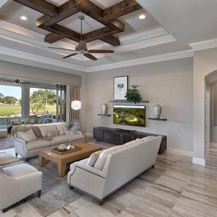 マイアミの中サイズの地中海スタイルのおしゃれなLDK (フォーマル、ベージュの壁、暖炉なし、壁掛け型テレビ、マルチカラーの床) の写真