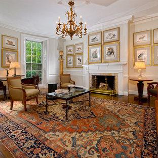Foto di un grande soggiorno chic chiuso con sala formale, pareti beige, parquet scuro, camino classico, cornice del camino in pietra e nessuna TV