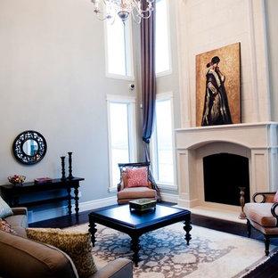 エドモントンの中サイズのヴィクトリアン調のおしゃれな独立型リビング (フォーマル、白い壁、濃色無垢フローリング、標準型暖炉、テレビなし、コンクリートの暖炉まわり、茶色い床) の写真