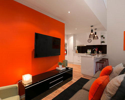 28 loft style living room with orange walls design ideas for Decoria interior designs