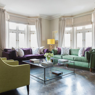 This is an example of a large classic living room in London with beige walls, dark hardwood flooring and brown floors.