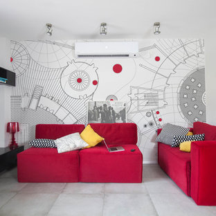 Imagen de salón tipo loft, moderno, de tamaño medio, con paredes rojas, suelo de cemento y televisor colgado en la pared