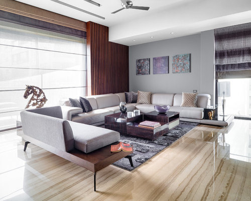Inspiration for a contemporary living room remodel in pune with brown walls